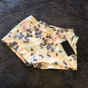 NWT. White denim shorts with floral print.
